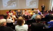 Four women interviewed in front of an audience. (© State Dept.)