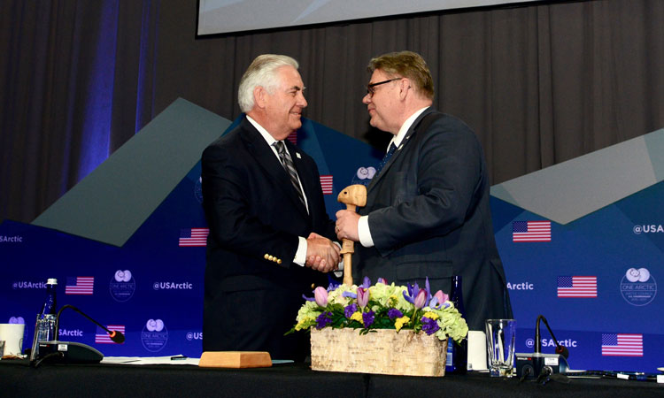 U.S. Secretary of State Rex Tillerson passes the Chairmanship gavel to Finnish Foreign Minister Timo Soini during the 10th Arctic Council Ministerial Meeting in Fairbanks, Alaska, on May 11, 2017. [U.S. Air Force photo / Public Domain]